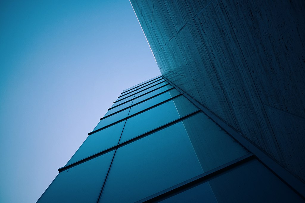 1024px-Glass_building_corner_%28Unsplash%29.jpg
